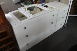 A contemporary three drawer chest with matching white three drawer chest and mirror