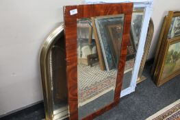 An overmantel mirror together with an antique style mirror,