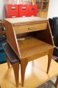 A teak telephone seat