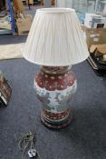 A Chinese table lamp on wooden stand