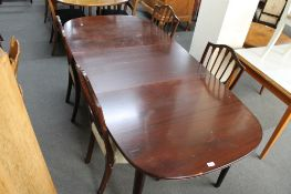 A mid century extending oval dining table and four chairs.
