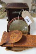 A calendar desk stand, barometer and compass,
