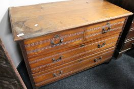 An Edwardian four drawer chest