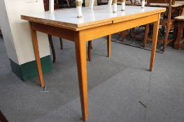 A mid century Formica topped extending kitchen table.