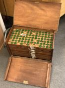 An antique mahogany coins collector's cabinet,
