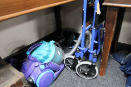A folding wheelchair and a Dyson vacuum
