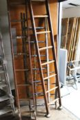 Four wooden ladders