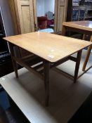 A teak low table and a further occasional table