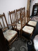 A set of six Ercol oak dining chairs