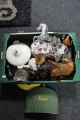 A box of Harrods tea cosy, wooden carvings,