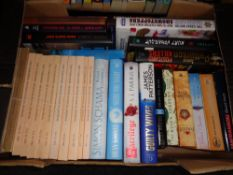 A box of hardback and paperback books; novels to include James Patterson,