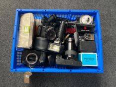 A crate of a quantity of assorted cameras and accessories