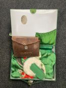 A hand stitched green silk Japanese style gown and slippers in case together with a leather cased