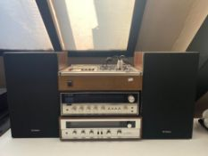 A Technics direct drive cassette stereo deck RS-279US together with a Technics FM AM stereo