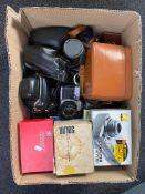 A box of a quantity of assorted cameras