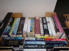 A box of hardback and paperback books;