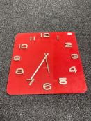 A red glass Karlsson battery operated wall clock