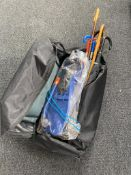 A holdall containing assorted walking sticks, umbrellas,