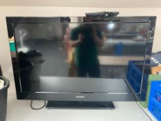 """A Curtis 39"""" LCD TV with remote"""