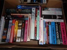 A box of hardback and paperback books; novels including Peter James,
