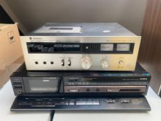 A Technics stereo cassette deck 610 together with a Aiwa stereo cassette deck AD-R460
