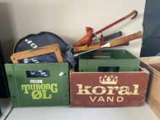 Two plastic Tuborg beer crates together with a wooden Koral beer crate,