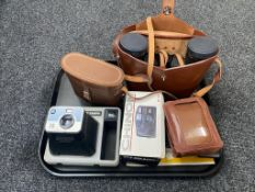 A tray of two sets of leather cased binoculars; Swift and Denhill,