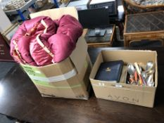 A box containing table linen, vintage quilt and bed cover,
