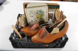 A crate of wooden clogs,