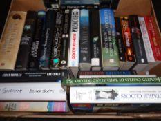 A box of hardback and paperback books; novels to include Martina Cole,