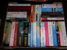A box of hardback and paperback books; novels to include Larsson,