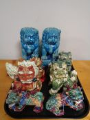 A tray of decorative Chinese dog figures