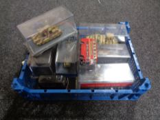 A crate of die cast vehicles, model tank,