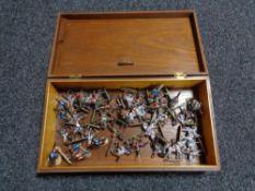 A mahogany box of military figures