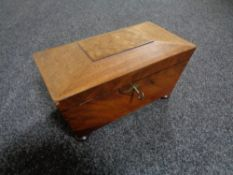 A 19th century mahogany tea caddy with key