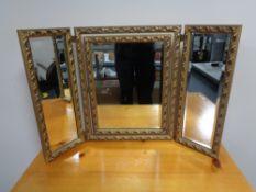 A decorative gilt framed dressing table mirror