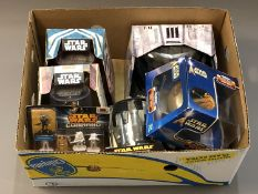 A collection of boxed Star Wars figures including boxed Star Wars die cast Titanium figures,
