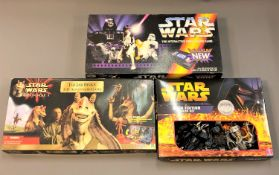 A collection of Star Wars games including Star Wars Saga Edition Monopoly,