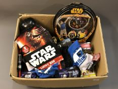 A box of Star Wars related collectables and sundries including gift bags, hats and caps,