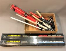 Two Star Wars Force FX Lightsaber collectable's, in original packaging,