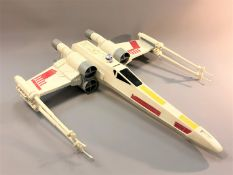 Two Star Wars model Millennium Falcons,