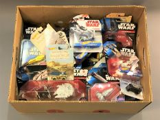 A collection of Star Wars Hot Wheels vehicles, all in original packaging.