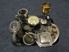 A tray of twentieth century plated wares, part tea service, napkin rings, goblet, cased servers,