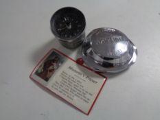 A vintage Jaguar wheel cap, Kienzle car clock and one book - Project cars the art of immersion.