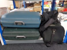 Two hardshell luggage cases together with a bag of various holdalls
