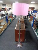 A contemporary metal four-way floor lamp with glass drops and pink shade