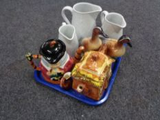 A tray of three Royal Worcester graduated jugs, Price Brothers teapot, character jug teapot,