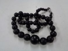 A Whitby Jet beaded necklace CONDITION REPORT: 90cm long. Clasp a/f.