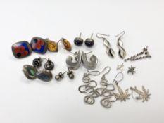 Twelve various pairs of silver earrings