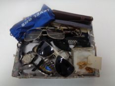 A box of gent's sun glasses, wrist watches,